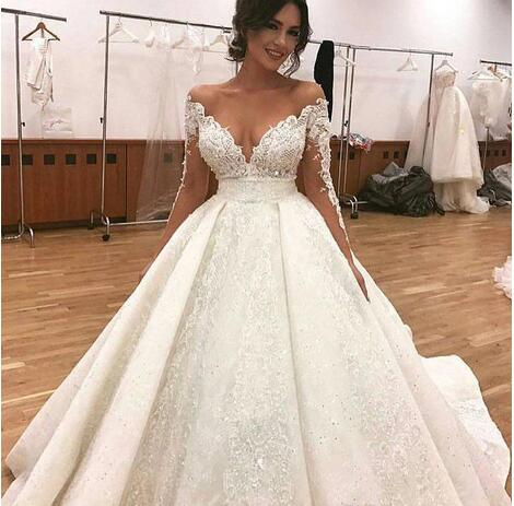 3074585fc2 Deep V-Neck Lace Wedding Dresses,Sexy Appliques Sheer Illusion Wedding  Dress,Long Sleeves Bridal Dresses,Off Shoulder Puffy Bridal Gowns Arabic  Dubai ...